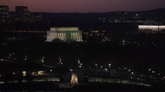 Flying above the Tidal Basin in Washington DC at night; Martin Luther King - stock footage