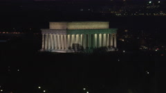 Orbiting the Lincoln Memorial at night, Kennedy Center passing by in background. Stock Footage