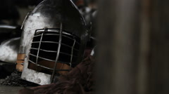 Medieval warriors putting on battle equipment, preparing for military campaign Stock Footage