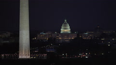 Flying past the Washington Monument at night, US Capitol Building in background. Stock Footage