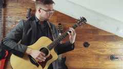 man playing the acoustic guitar slow motion - stock footage