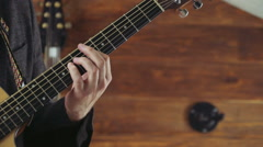 close up male hand taking chords on acoustic guitar slow motion - stock footage