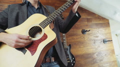 Close up man playing the acoustic guitar slow motion Stock Footage