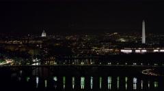 Flying above the Potomac toward Key Bridge at night, Capitol and Washington Stock Footage