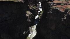 Steep look down into dark and narrow Malad Gorge, Idaho Stock Footage