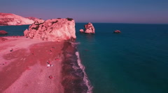 AERIAL: Flying around Petra tou Romiou - Rock of Aphrodite, Cyprus Stock Footage
