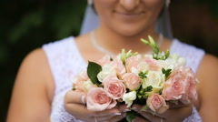 Bride in the wedding dress with bouquet in the park Stock Footage
