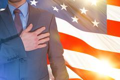 American Proud Patriot Keeping His Hand on a Heart. - stock photo