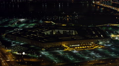 Gradual approach to the Pentagon at night, Potomac River in background. Shot in Stock Footage