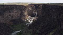 Waterfall under highway bridge in Malad Gorge, Idaho Stock Footage
