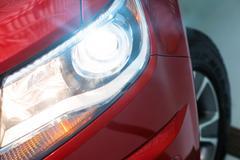 Vehicle Xenon Headlight. Modern Car Lighting Closeup - stock photo