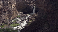 Waterfall among rugged cliffs in Malad Gorge, Idaho Stock Footage
