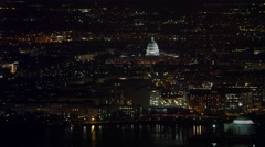 Flying over the Tidal Basin at night, US Capitol Building in distance, Jefferson - stock footage
