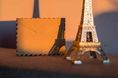 Empty vintage card with statuette of Eiffel Tower. Stock Photos