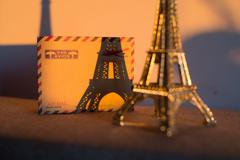 Empty vintage card with statuette of Eiffel Tower Stock Photos