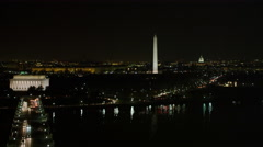Lincoln Memorial at night with traffic on George Washington Memorial Parkway in Stock Footage
