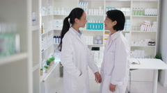 4K Portrait of female business partners in a chemist shop  Stock Footage