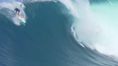 MAUI, HAWAII.  Surfers Ride Giant Ocean Waves Breaking  Stock Footage