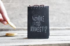 Where To Invest. Investor idea. - stock photo