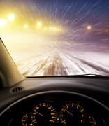 snow-covered road at night - stock photo