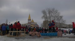 Orthodox Baptism Celebration in Kiev People Immersing in Cold Water Running - stock footage