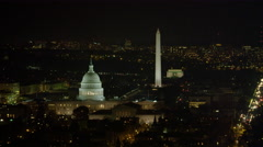 Orbiting Capitol Hill at night; Washington Monument and Lincoln Memorial in Stock Footage
