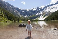 Stock Photo of Child wading in water at Glacier National Park, Montana, USA