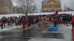 Orthodox Baptism Celebration in Kiev People Bathing in Cross-Shaped Hole - stock footage
