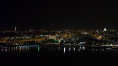 Looking north from above the Potomac River at night, Washington Monument and Stock Footage