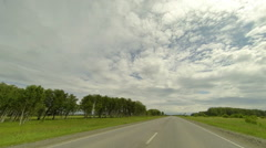 Clouds over the road. The path from Krutinka village, Omsk region, Russia Stock Footage