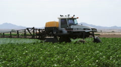 Close-up crop sprayer moving through a field Stock Footage