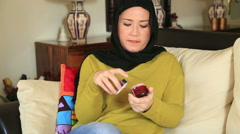 Muslim woman applying some white lotion on her hand Stock Footage