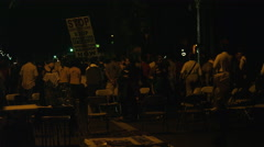 Protesters gathering for a march after a candlelight vigil Stock Footage