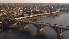 Crossing Key Bridge on the Potomac, looking east to Georgetown and  Washington Stock Footage