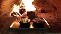 Snail escargot pans, in a wooden heated oven, at a restaurant kitchen - stock footage