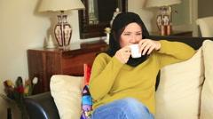 Muslim woman drinking coffee 4 Stock Footage