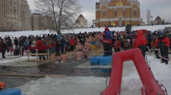 Orthodox Baptism in Dnieper Celebration Kiev People Are Bathing in Cold Water - stock footage