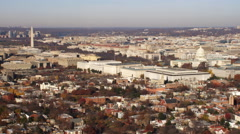 Wide view of National Mall and Capitol Hill in Washington DC; flight crosses - stock footage