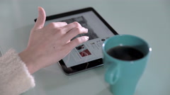 Right hand of a woman using her tablet on a table at home, minimalist design Stock Footage