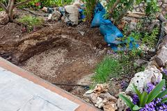 Hole Excavated In The Ground For Pond Construction - stock photo
