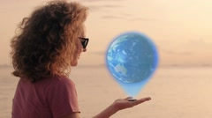 Earth in   human hand. Peaceful Girl with glowing futuristic Hologramic Stock Footage