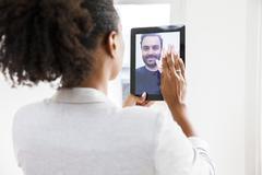 Couple doing video chat Kuvituskuvat