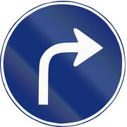 Road sign used in Spain - Right turn ahead - stock illustration