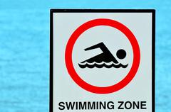 Authorise swimming zone sign Stock Photos