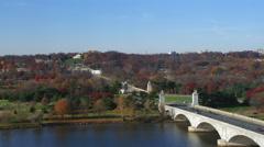 Flying over Arlington Memorial Bridge on the Potomac towards Arlington National Stock Footage