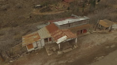 Downward aerial on old abandoned historical house in Jerome Arizona Stock Footage