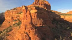 Slow aerial forward on Sedona Red Rock Formations- Kachina Woman Stock Footage