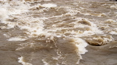 Close-up rapids on a flooding river - stock footage