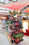 duty free cosmetics shopping before Christmas, airport of Bangkok - stock photo