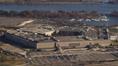 Flying past the Pentagon, zoom-out reveals glimpse of Washington DC in - stock footage